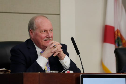 County Attorney Herbert Thiele listens at the County Commission meeting Tuesday, June 18, 2019.