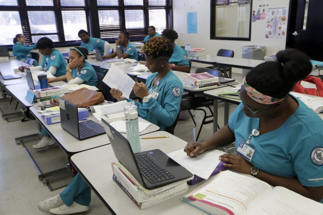 Medical assistant students work in their classroom Wednesday, Jan. 9, 2019 at Lively Technical Center which has been approved by the Leon County School Board to change it's name to Lively Technical College.