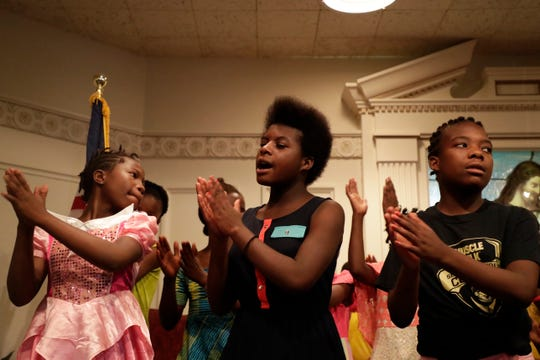 Members of the Swahili Children's Choir sing and dance during a service in the chapel of First Baptist Church Sunday, June 16, 2019.