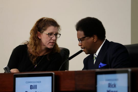 Commissioners Kristin Dozier, left, and Bill Proctor both voted in favor of developing a draft marijuana decriminalization ordinance Tuesday.