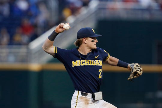 Jun 17, 2019; Omaha, NE, USA; Michigan Wolverines shortstop Jack Blomgren (2) throws to first base in the eighth inning against the Florida State Seminoles in the 2019 College World Series at TD Ameritrade Park. Mandatory Credit: Bruce Thorson-USA TODAY Sports