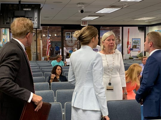 Martin County Commissioner Sarah Heard, center, speaks with her defense lawyers -- Jordan Wagner, on right, and Barbara Kibbey Wagner, on left, -- on Tuesday shortly before the Martin County Commission discusses paying Heard's $450,000 in legal fees related to her April acquittal on public-records violations.