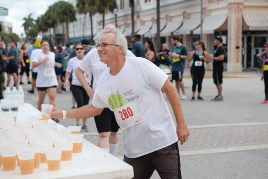 James Cunningham is thirsty from running in the 2019 Sailfish Beer Mile in downtown Fort Pierce. The race raised over $6,000 for the Early Learning Coalition of St. Lucie County.