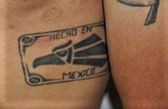 "The Mexicles gang uses the ""Hecho en Mexico"" eagle logo. But not everyone with the tattoo is a member of the gang."