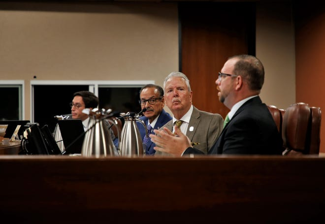 El Paso County Commissioner David Stout (on right) explains his support for a historic survey on Downtown properties during a County Commissioners meeting in 2019