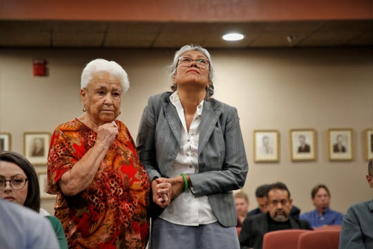 Duranguito resident Antonia Morales (on left) is helped to the podium at the El Paso County Commissioners Court by Selfa Chew Smithart (on right).