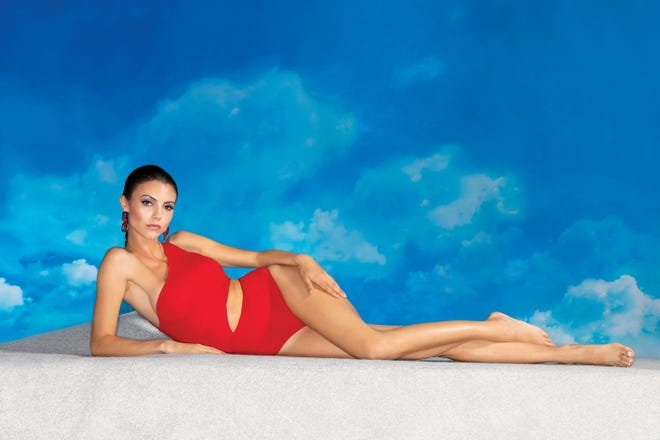 Red one piece by Oye from Splash on Main. Earrings from Monkees of the West End.