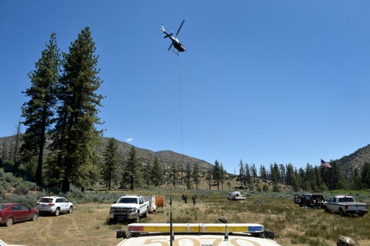 U.S. Forest Service officers prepare to be flown by helicopter into a remote canyon near Lockwood Valley on Tuesday to clean up the site of an illegal marijuana growing operation in Los Padres National Forest.