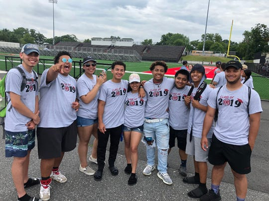 Members of the Vineland High School Class of 2019 at Gittone Stadium rehearsing for their  commencement ceremony.