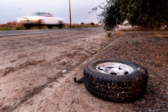 Just chemical stains remain in the roadway after a head-on collision killed one on Road 224 just north of Avenue 278 north of Porterville on Monday, June 17, 2019.