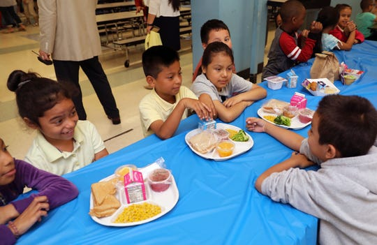 Students at the Enrico Fermi School in Yonkers, sit at a table in the cafeteria with recyclable food plates, June 18, 2019. As of March 2019, all 40 Yonkers Public Schools eliminated the use of polystyrene trays, known as Styrofoam, with 100% recyclable food trays. Polystyrene does not biodegrade and pollutes air and waterways.