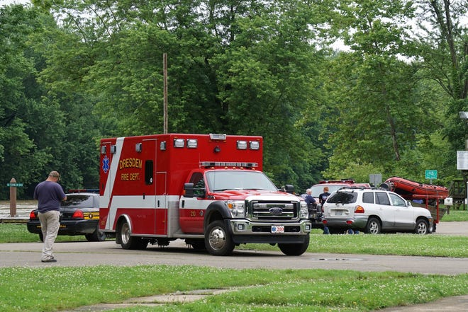 Emergency vehicles are shown around the boat ramp at Village Park in Dresden on Tuesday. A man's body was recovered from the Muskingum River around 10 a.m.