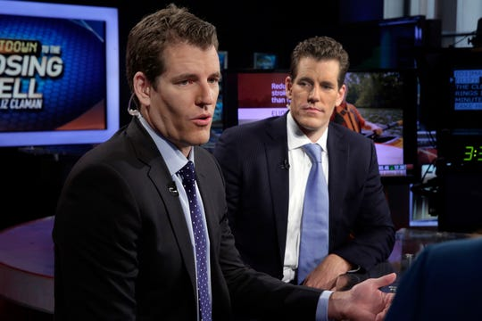 In this Thursday, Oct. 8, 2015 file photo, Tyler Winklevoss, left, and Cameron Winklevoss, founders of Gemini Trust Co., appear on the Fox Business Network, in New York. Tyler and Cameron Winklevoss are once again seeing Mark Zuckerberg steal their thunder with Facebook's Libra digital currency.