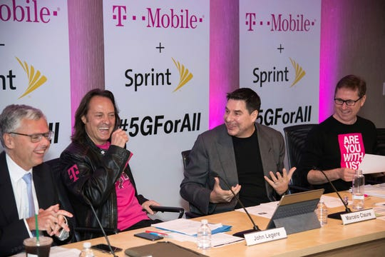 From left, Sprint President Michel Combes, T-Mobile CEO John Legere, Sprint CEO Marcelo Claure and T-Mobile President Mike Sievert in 2018 in New York.