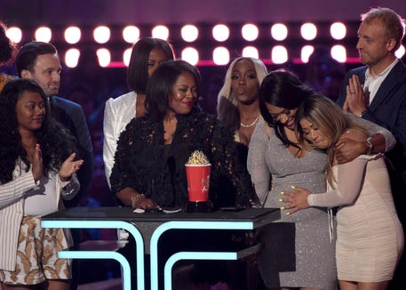 "Participants and crew from ""Surviving R. Kelly"" accept the award for best documentary at the MTV Movie & TV Awards."