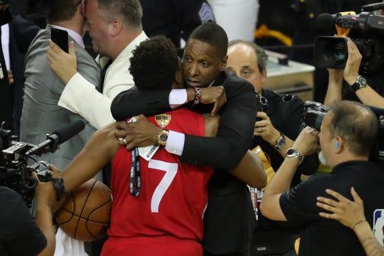 Masai Ujiri hugs guard Kyle Lowry after the Raptors won the NBA championship.