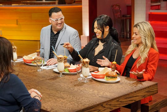 'Family Food Fight' judges Graham Elliot, left, Ayesha Curry and Cat Cora assess the meal prepared by one of ABC cooking show's competing families.