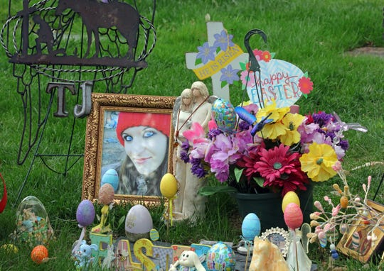An arrangement of photos, flowers and Easter eggs surrounds the grave of Tanna Jo Fillmore on Friday, April 26, 2019, in Salt Lake City.