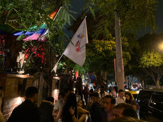 Patrons congregate on the sidewalk outside of The Abbey, a celebrated gay bar in West Hollywood, California, after the bar closed early on the morning of Saturday, June 15, 2019.