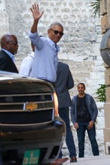 Former President Barack Obama waves during a family vacation with Michelle Obama and daughters Malia and Sasha in Avignon in the south of France, on June 16, 2019.