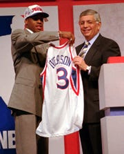 Allen Iverson holds up a jersey with former NBA commissioner David Stern after being selected as the top pick in the '96 NBA draft.