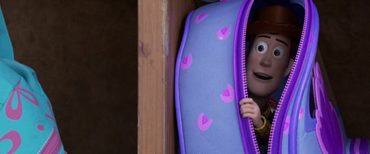 "Woody (voiced by Tom Hanks) stows away in Bonnie's bookbag to help her out during kindergarten orientation in ""Toy Story 4."""