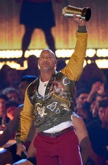 Dwayne Johnson accepts the generation award at the MTV Movie and TV Awards.
