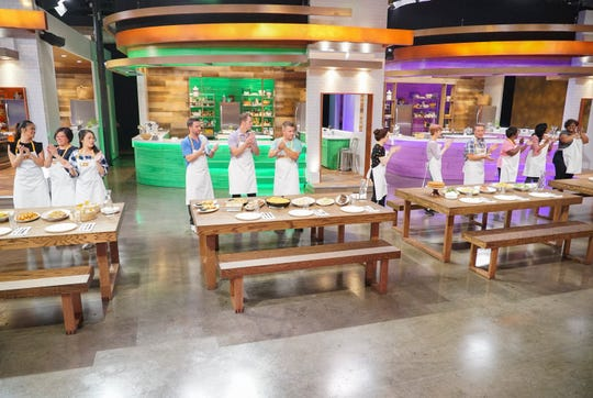 Competing teams prepare to have their meals judged on the colorful set of ABC's 'Family Food Fight.'