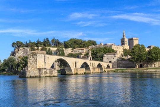 The famous bridge at Avignon, with the fortress Palace of the Popes in the background.