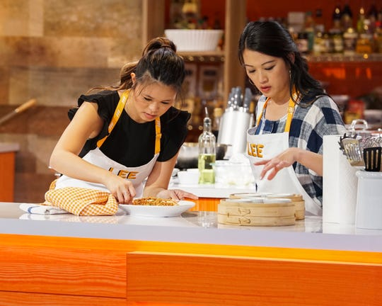 The Lee sisters, who form a cooking team with their mother, prepare a meal during an episode of ABC's 'Family Food Fight.'