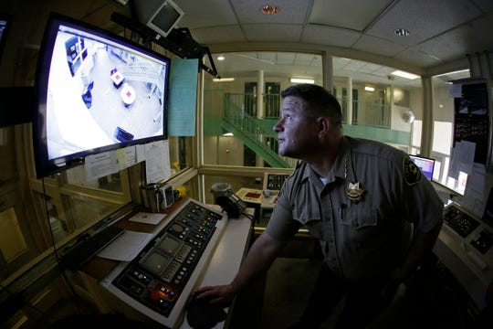 Sheriff Brian Martin looks at a video monitor in a control area of the Lake County Jail in Lakeport, Calif., on Tuesday, April 16, 2019.