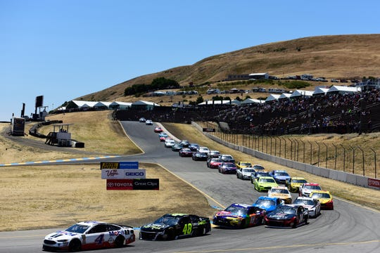 Kevin Harvick (4) leads Jimmie Johnson (48) and Kyle Busch (18) during the 2018 NASCAR Cup race at Sonoma Raceway. This year's race will include five new turns.