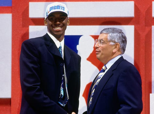 Kobe Bryant poses with NBA commissioner David Stern.