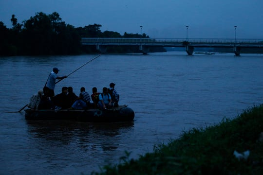 "A group of migrants arrives from Guatemala by the ""Coyote Pass"" raft route, to Ciudad Hidalgo, Mexico, Monday, June 17, 2019."