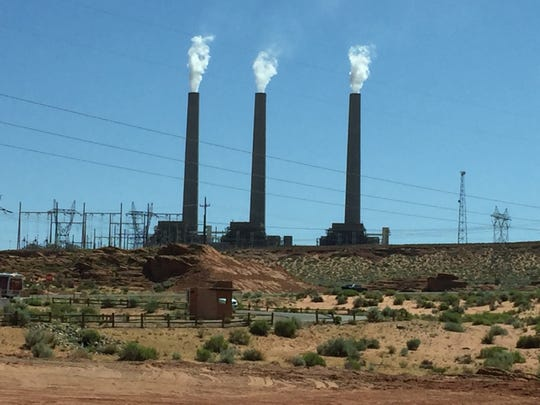 The Navajo Generating Station coal-fired power plant near Page, Arizona, is slated to close by December 2019.