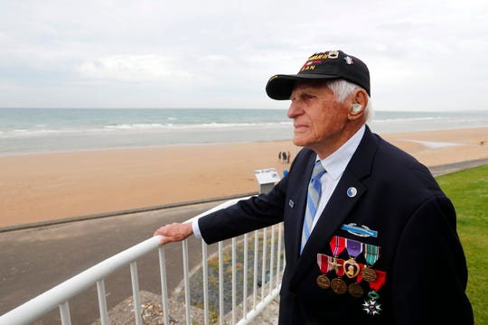 Steve Melnikoff looks out over Omaha Beach in Normandy, France. The 99-year-old veteran met with family members of the USWNT on Tuesday.