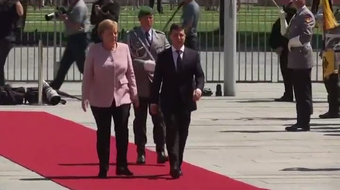 German Chancellor Angela Merkel appeared unsteady and was visibly shaking Tuesday as she greeted the new Ukrainian leader in the hot sun in Berlin.