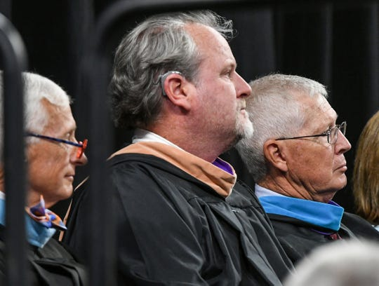 Anderson School District 2 board members Phil Ashley, left, Kevin Craft, and Jimmy Ouzts attends the Belton-Honea Path High School graduation in Littlejohn Coliseum in Clemson in May.