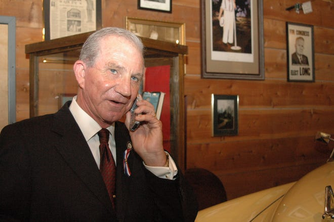 Louisiana Senate President Don Hines, receives a congratulatory phone call before his induction into the Louisiana Political Hall of Fame in 2006.