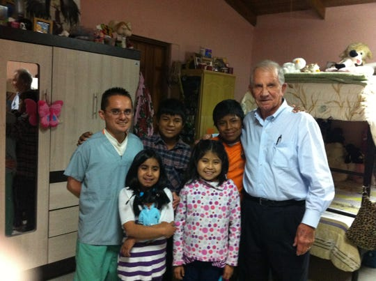 Don Hines (right) poses in 2015 with children at Casa Aleluya undergoing dialysis treatment, along with Aroldo (left), a former orphanage resident who is now a registered nurse.
