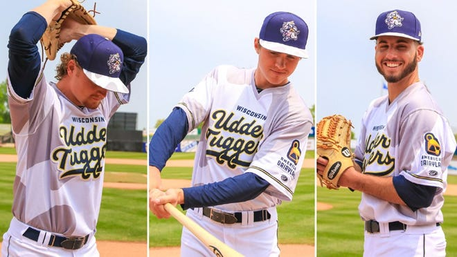 Wisconsin Timber Rattlers Scotty Sunitsch, left to right, Chad McClanahan, and Peter Strzelecki model the Wisconsin Udder Tuggers uniforms.