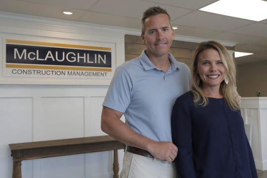 Chris Carr, left, president of McLaughlin Construction Management, poses with his wife Kristy Carr in their office in Sea Isle City, N.J. When Kristy's father Jim McLaughlin died suddenly from a heart attack at age 64, his family assumed they would have to close his homebuilding business. But as McLaughlin's son-in-law, Chris, started to wind down the company five years ago, he realized it was worth keeping open and that he, an accountant, should try to run it.