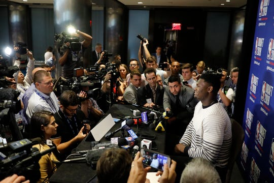 Zion Williamson, a freshman basketball player from Duke, attends the NBA Draft media availability, Wednesday, June 19, 2019, in New York. The basketball draft will be held Thursday, June 20. (AP Photo/Mark Lennihan)