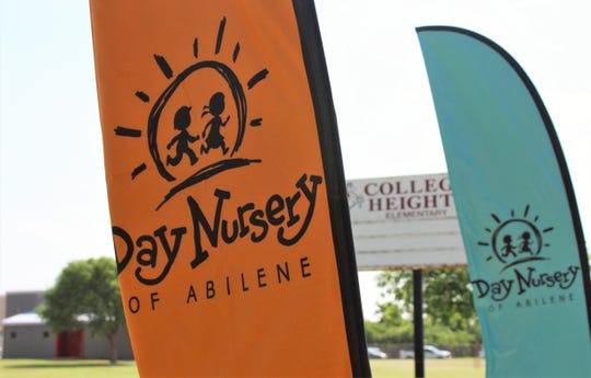 Day Nursery banners are extended by a strong southerly breeze Wednesday on the former College Heights Elementary School campus, where a fourth child-care location will be located.