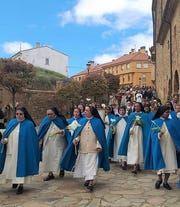 Nuns in Agreda, Spain, honor the Lady in Blue by wearing blue capes in a processional in Agreda after the baptism of Harley Flores of Abilene in May