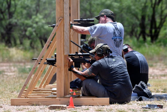 John Lopez of the Abilene Police Department is seated at the end of a line of other shooters during the sniper/precision firing rifle competition Wednesday afternoon at APD's Warren Dodson Training Complex. The contest is part of this week's Texas Police Games.
