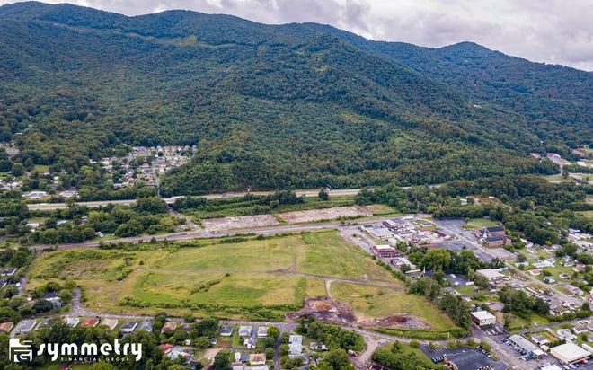 Symmetry Financial Group, an insurance marketing company, said June 19 it has purchased a 42-acre Whitson Avenue property in Swannanoa, the former site of a Beacon Mill blanket manufacturing plant.