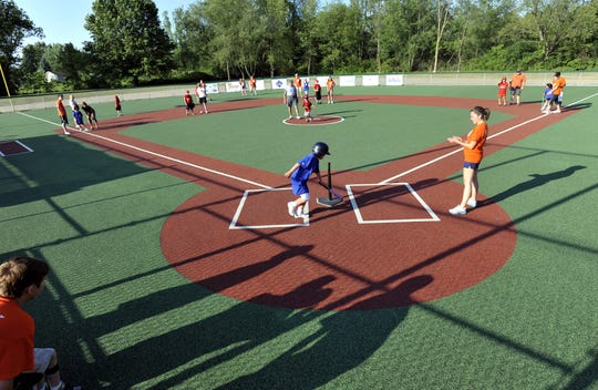 A Miracle League of Mid-Michigan game at Case Cares Miracle Field in DeWitt Township Wednesday, June 20, 2012. The league helps kids with physical and cognitive challenges take part playing ball with a team on a barrier-free field.