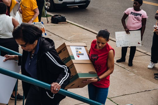 Civil Rights groups Color Of Change and the NAACP-Broome Tioga Chapter and community members brought a boxes containing a petition to the Binghamton City School District's Board of Education during a board meeting on June 18, 2019.