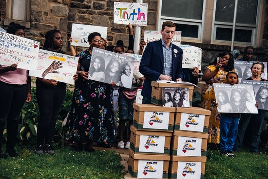 "Color Of Change Campaign Director Evan Feeney speaks during a rally held outside of Columbus School in Binghamton before a Board of Education meeting on June 18, 2019. Feeney presented the Board of Education with boxes containing petitions protesting ""district's unsafe learning environment for Black students and students of color."""